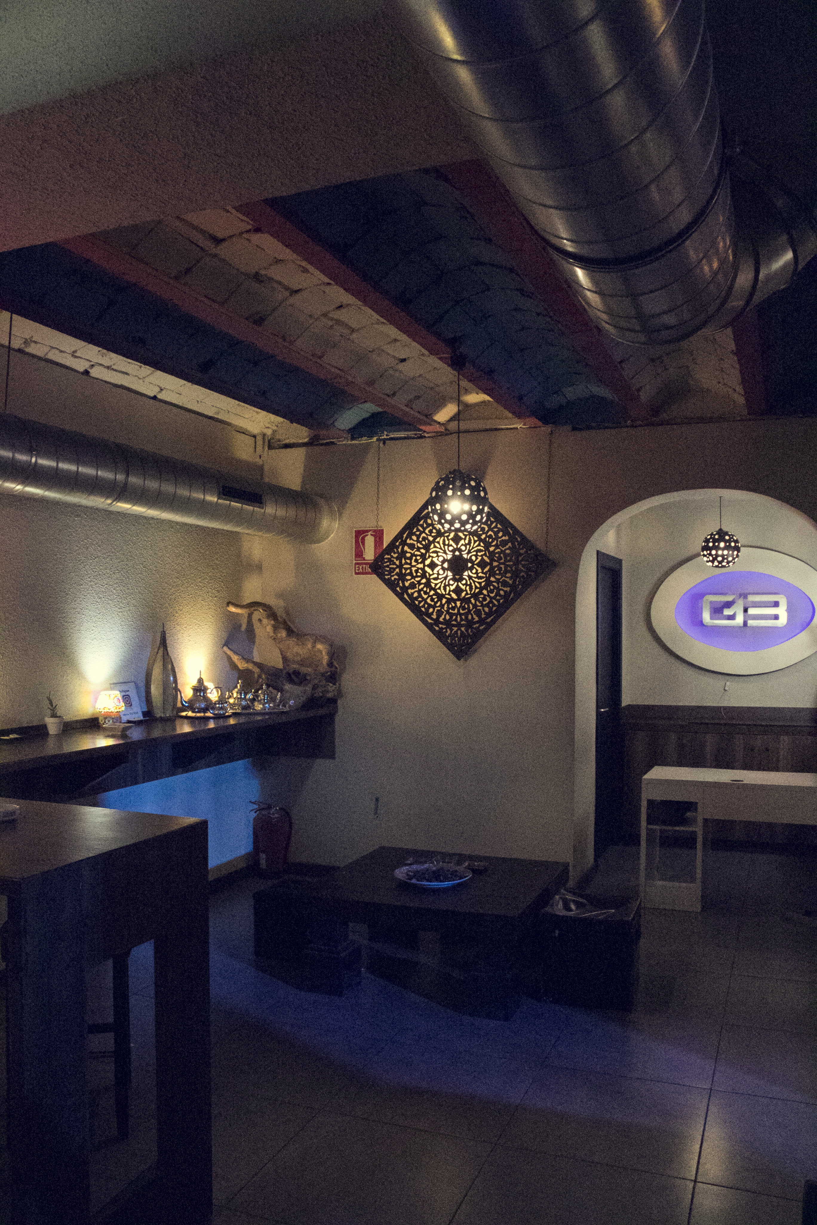 g13 cannabis club chilling area with logo on the wall