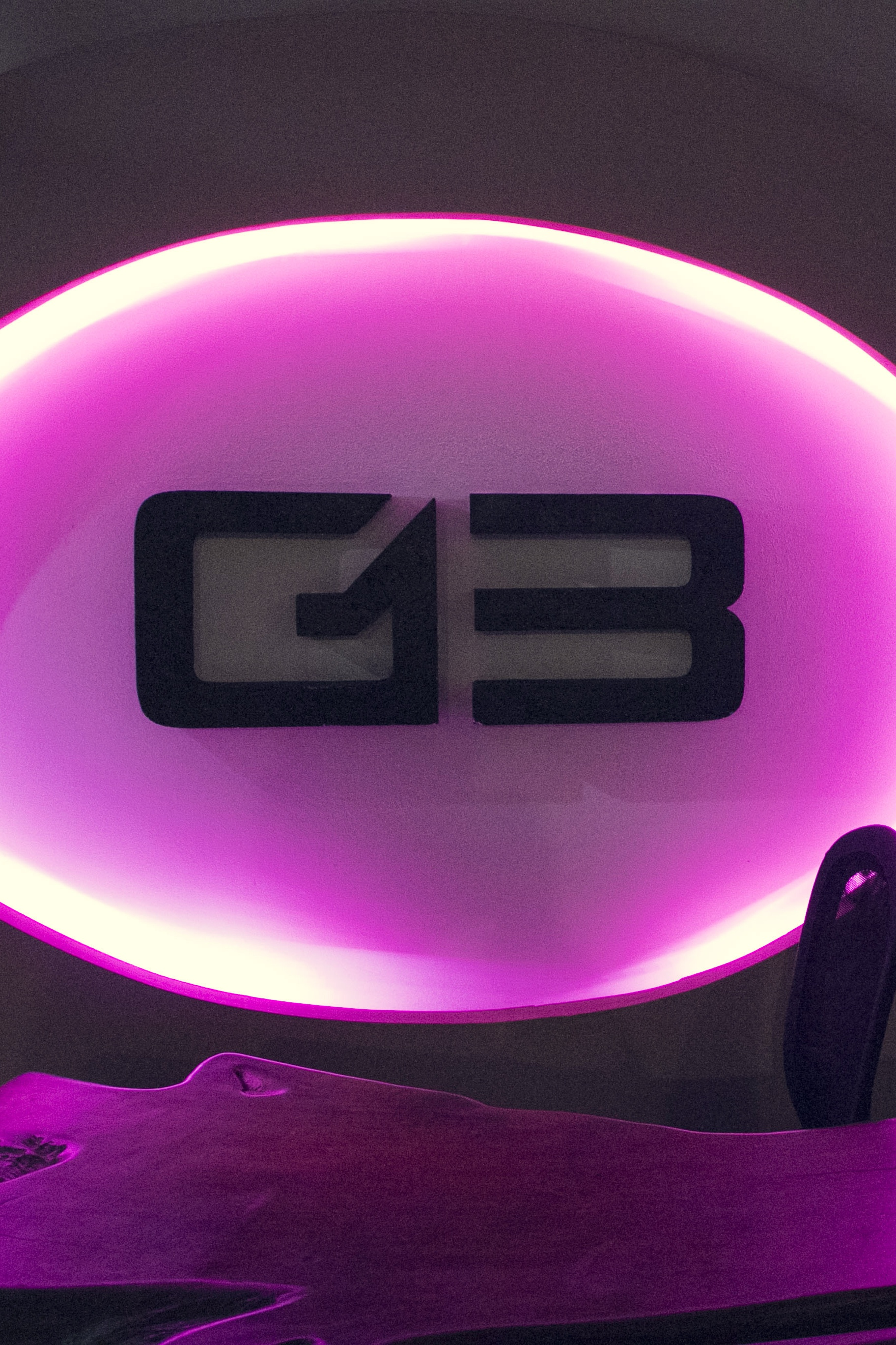 g13 cannabis club logo on the wall light up pink